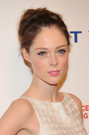 Coco Rocha swept her hair up up and added double slim black headbands to create her romantic look.
