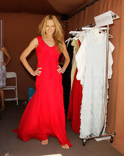 Natasha showed off a stunning vibrant red evening dress while attending the Pre-Emmy gift suite.
