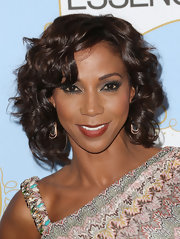 Holly Robinson Peete opted for a more subtle and natural beauty look with deep berry lips.
