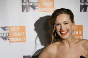 Petra dons an orange hued lipstick for the Focus for Change Benefit Dinner.