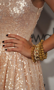 Autumn showcased gold bangle bracelets while hitting the Pink Party.