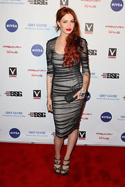 Porcelain Black attended a pre-Grammy party in LA wearing a super-sexy figure-hugging ruched mesh dress.