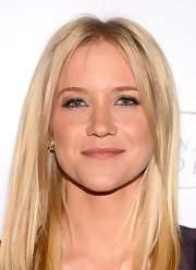 Jessy Schram kept her look sleek and contemporary with a straight 'do.