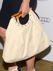 Amy Brenneman chose a cream leather tote with bamboo handle and stud detailing for her carry all while at the Television Academy Honors.