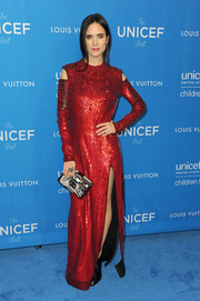 Jennifer Connelly shimmered in her red cut-out gown that featured a thigh baring slit and long-sleeves.