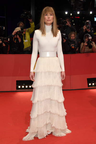 Rosamund Pike kept it minimal up top in a white turtleneck at the Berlinale premiere of '7 Days in Entebbe.'
