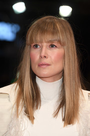 Rosamund Pike went old school with this straight hairstyle with very blunt bangs at the Berlinale premiere of '7 Days in Entebbe.'