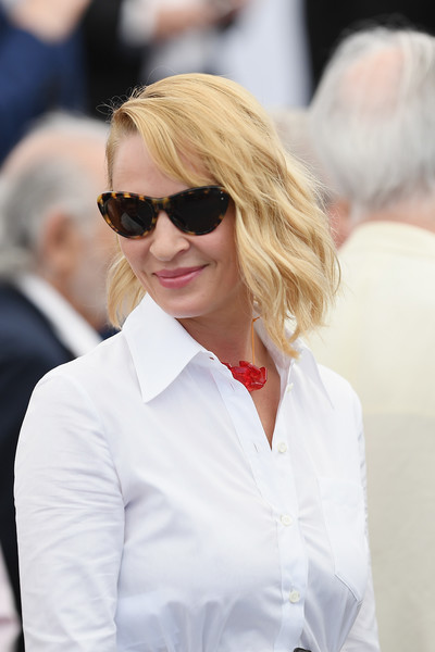 Uma Thurman looked summer-chic with her wavy bob at the Cannes Film Festival 70th anniversary photocall.