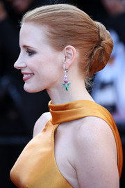 Jessica Chastain's Piaget sapphire, ruby, emerald, and diamond chandelier earrings worked gorgeously with her marigold dress!