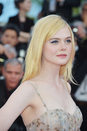 Elle Fanning kept her beauty look fun with some winged blue eyeliner.
