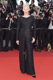 Tilda Swinton rocked a black sequin jumpsuit by Chanel at the Cannes Film Festival 70th anniversary event.