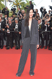 Liu Wen stayed casual and cool in this striped jumpsuit and jacket combo by Jean Paul Gaultier at the Cannes Film Festival 70th anniversary event.