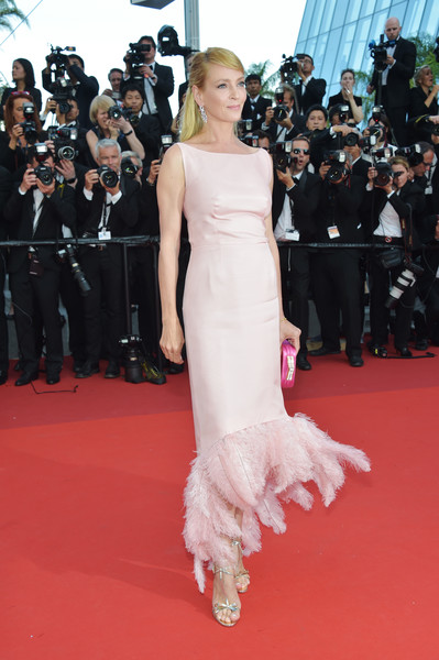 Uma Thurman amped up the sweetness with a pair of bowed T-strap sandals by Christian Louboutin.