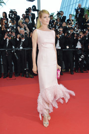 Uma Thurman looked picture-perfect in a pink Prada cocktail dress with a feather-festooned hem at the Cannes Film Festival 70th anniversary event.