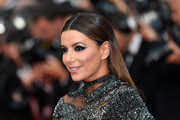 Eva Longoria opted for a sleek center-parted style when she attended the Cannes Film Festival 70th anniversary event.