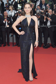 Marion Cotillard was sleek and sophisticated in a strapless midnight-blue Armani Privé gown with an angular neckline and an up-to-there slit at the Cannes Film Festival 70th anniversary event.