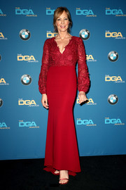 Red satin sandals by Stuart Weitzman polished off Allison Janney's look.