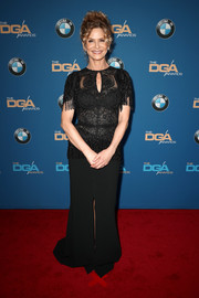 Kyra Sedgwick donned a black Zuhair Murad gown with fringed sleeves and hips for the 2018 Directors Guild of America Awards.