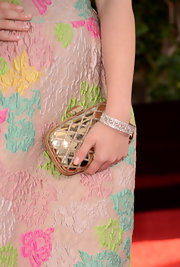 Ariel Winter added some flash to her Golden Globes look with a metallic gold clutch.