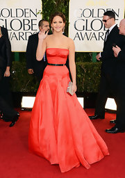Jennifer Lawrence walked the Golden Globes red carpet holding a silver box clutch.