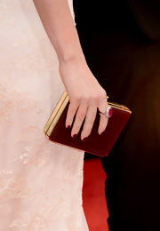 Megan Fox matched her burgundy mani to her box clutch.