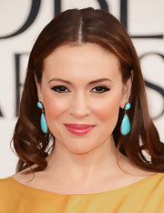 Alyssa Milano accented her Globes gown with a pair of turquoise danglers.
