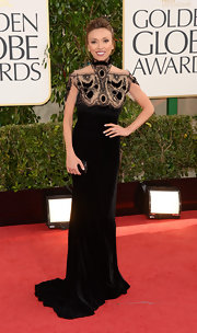 Giuliana looked so Victorian in this black velvet dress with a lacy high neck for the Golden Globe Awards.