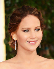 Jennifer Lawrence accessorized her strapless Dior gown with a pair of diamond danglers.