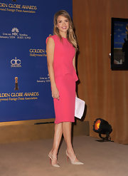Jessica Alba accented her pink peplum dress with a pair of Christian Louboutin slingback heels.