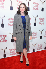 Tina Fey arrived for the 2018 Writers Guild Awards wearing a gray tweed coat with ruffled pocket flaps.