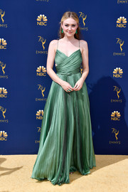 Dakota Fanning looked downright divine at the 2018 Emmys in a pleated green Dior Couture gown with a crossover bodice.