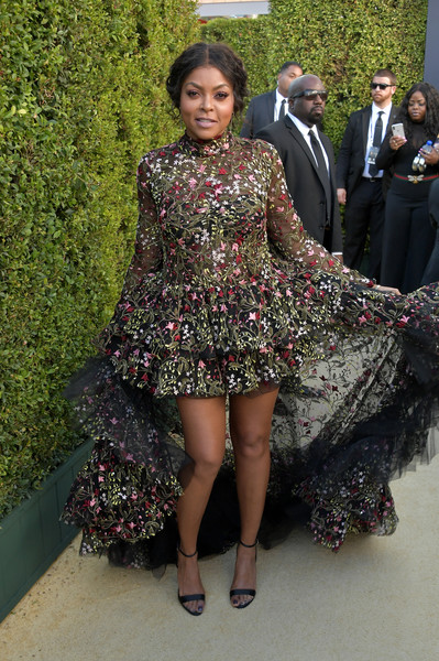 Taraji P. Henson showed off her legs in an intricately embroidered fishtail dress by Giambattista Valli at the 2018 Emmys.
