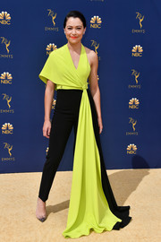 Tatiana Maslany was all about cool glamour in an asymmetrical neon-yellow and black jumpsuit by Christian Siriano at the 2018 Emmys.