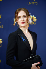 Evan Rachel Wood teamed a geometric velvet clutch by Tyler Ellis with a pantsuit for the 2018 Emmys.