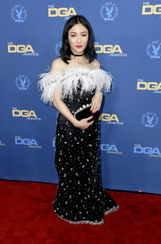 Constance Wu coordinated her look with a black velvet clutch with pearl embellishments, also by Miu Miu.