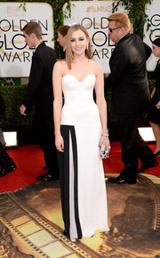 Laura Carmichael looked modern and sexy in a monochrome strapless corset gown by Viktor & Rolf during the Golden Globes.