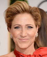 Edie Falco attended the Golden Globes wearing a towering pompadour.