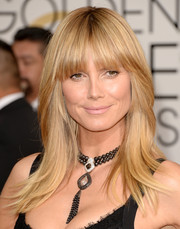 Heidi Klum sported a casual layered cut with blunt bangs when she attended the Golden Globes.