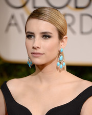 Emma Roberts looked seriously chic with her lustrous ponytail during the Golden Globes.