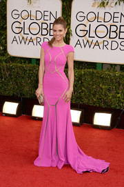 Maria Menounos brought a dose of color and sexiness to the Golden Globes red carpet with this bright pink Max Azria Atelier gown featuring see-through panels.