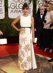 Rashida Jones brought a summer vibe to the Golden Globes red carpet in a sleeveless white Fausto Puglisi gown with tropical-inspired beading on the skirt.