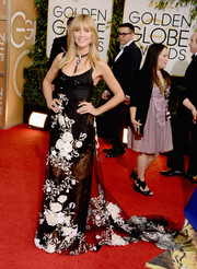 Heidi Klum looked sensual in a lingerie-inspired sheer lace gown by Marchesa during the Golden Globes.
