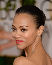 Zoe Saldana pulled her back into a tight bun for the Golden Globes.