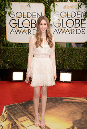 Taissa Farmiga kept it girly in a white lace cocktail dress by Elie Saab when she attended the Golden Globes.