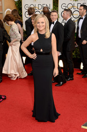 Amy Poehler was modern and chic on the Golden Globes red carpet in a black Stella McCartney gown with an asymmetrical bodice and peekaboo detail.