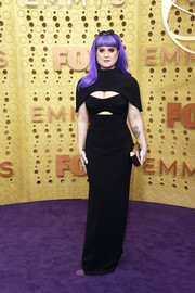 Kelly Osbourne cut a slim silhouette in a black column dress with a cutout bodice and capelet detailing at the 2019 Emmy Awards.