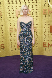 Michelle Williams glammed up in a strapless, floral-embroidered column dress by Louis Vuitton for the 2019 Emmy Awards.