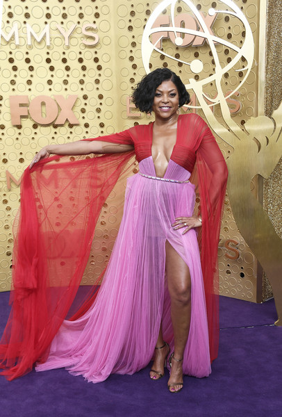 Taraji P. Henson looked sassy in a color-block Vera Wang gown with a navel-grazing neckline and floor-length sleeves at the 2019 Emmy Awards.