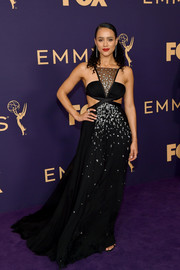 Nathalie Emmanuel went for edgy glamour in an embellished black cutout gown by Miu Miu at the 2019 Emmy Awards.