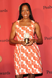 Regina King showed off her breezy style with an orange and white print dress at the George Foster Peabody Awards.